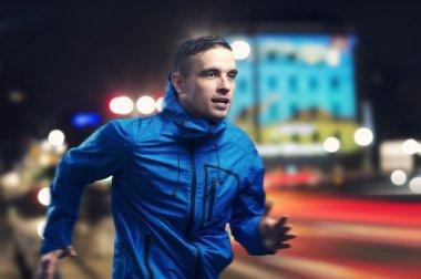 Sportsman Jogging at night