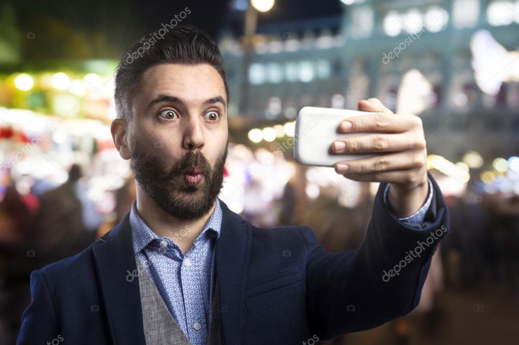 Hipster man taking selfie