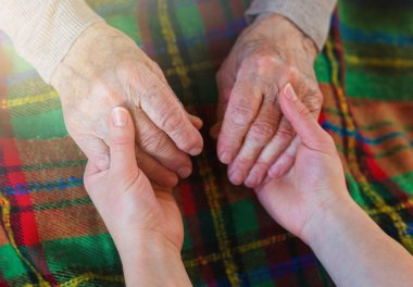 Grandmother and granddaughter holding hands.
