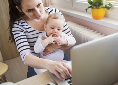 Mother with daugher working from home