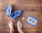 Fotografie Nohy běžce, medaili a závod čísla