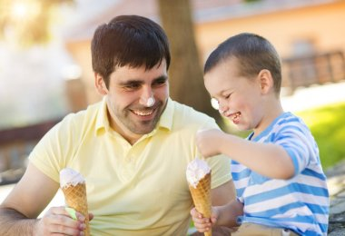 Father and son enjoying ice cream