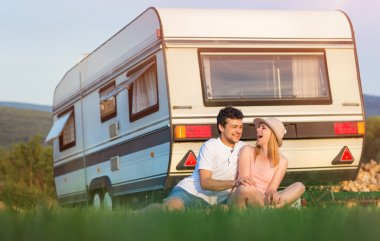 couple travelling with camper