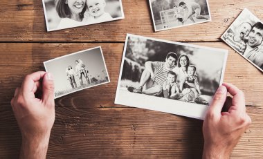 family photos in hands