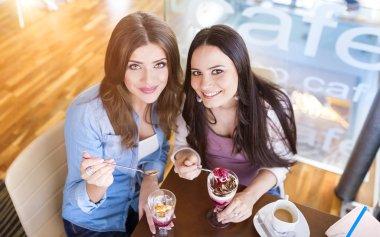 Two women having fun in a cafe