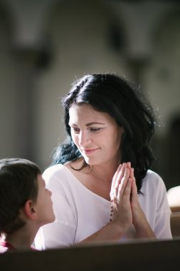 Woman with her son praying
