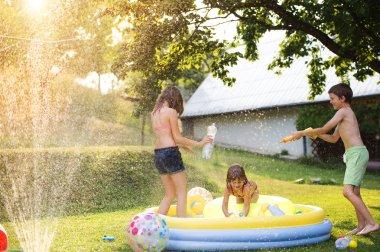 Children having fun outside in the garden