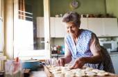 Fotografie Senior woman baking