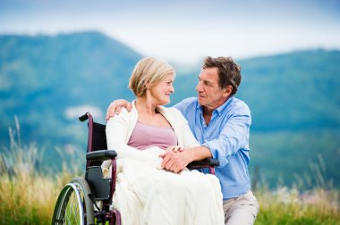 Man with woman in wheelchair
