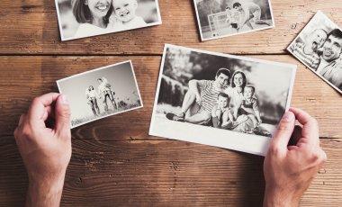 Family photos laid on a table