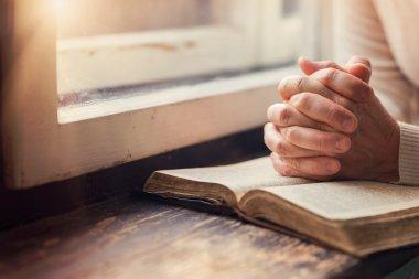 Woman praying with Bible