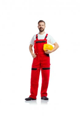 Young handsome worker in red overalls. Studio shot on white background stock vector
