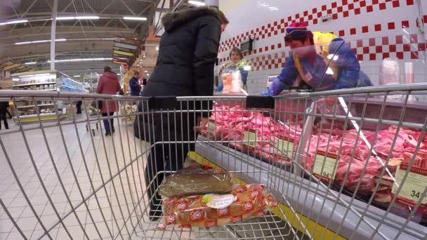 03/23/2016 Minsk, Belarus, hypermarket Euroopt: Buying products in the hypermarket. Buying meat, eggs and products.