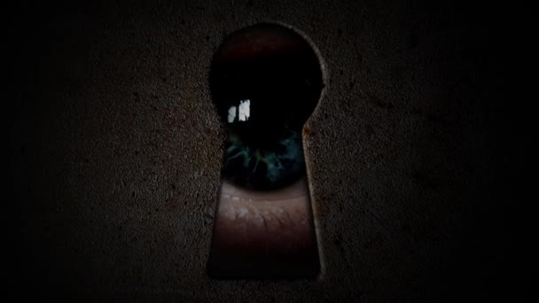 Eyes watching through a keyhole. Watch through the dark keyhole