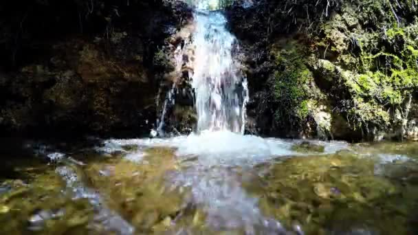 Pure fresh water waterfall in forest. Holy spring