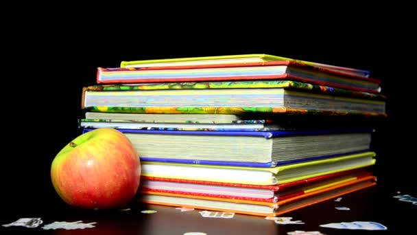 A pile of childrens books with a pencil and apple on top. Teachers pet. books stacked with formulas fund, education.