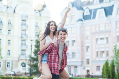 Happy young couple laughing in the city. Love Story series.