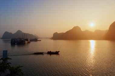 Ha long bay Silhouettes of Rocks and ships Vietnam