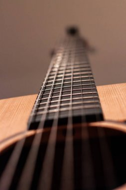 Guitar with focus on its strings