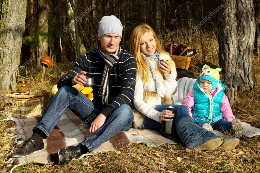 Young happy family in nature