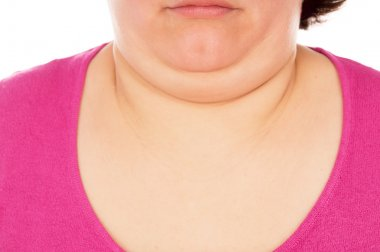 Full woman shows the second chin