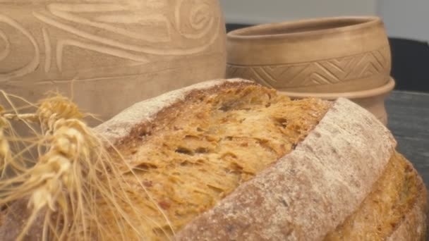 Close-up of fresh baked whole grain bread move in slow motion.