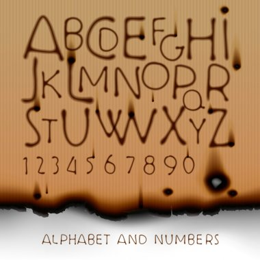 Vintage alphabet and numbers on burned out paper background