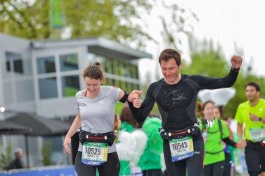 PARIS, FRANCE - APRIL  06 : marathon runners finishing line at Paris International Marathon on April 06, 2014 in Paris, France