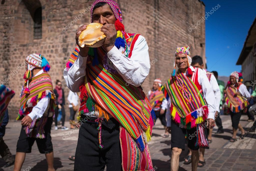 Unknown Peruvian people in traditional clothes on a carnival in