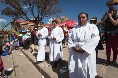 Unknown people participate in the Godfather to the course on a religious holiday in Cuzco, Peru