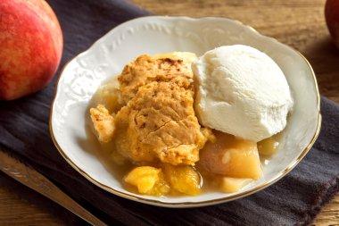 peach cobbler with ice cream