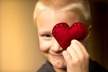 Happy child with red heart