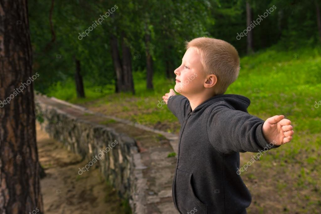 Child breathing in forest