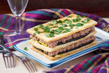 French appetizer millefeuille with eggplant, cream of beans, mea