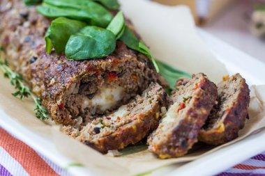 Meat roll, meatloaf, minced beef with vegetables, olives, mozzar