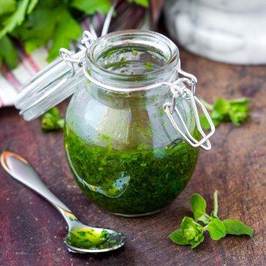 Green sauce marinade from herbs oregano, parsley, oil, tradition