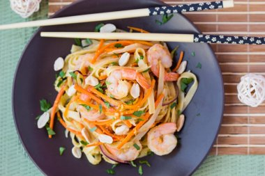 Asian noodles with shrimp, vegetables, carrots, peanuts, onions,