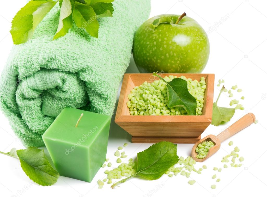 spa setting with products of green apple