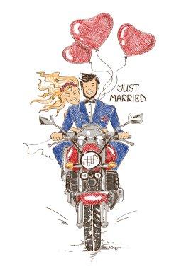 Wedding couple riding on a motorbike