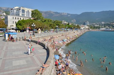 Vacation by the sea on the waterfront in the city of Yalta. Crimea, Ukraine. Summer 2012
