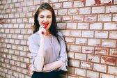 Fotografie Close up fashion portrait of pretty seductive young woman posing outdoor. Red lips