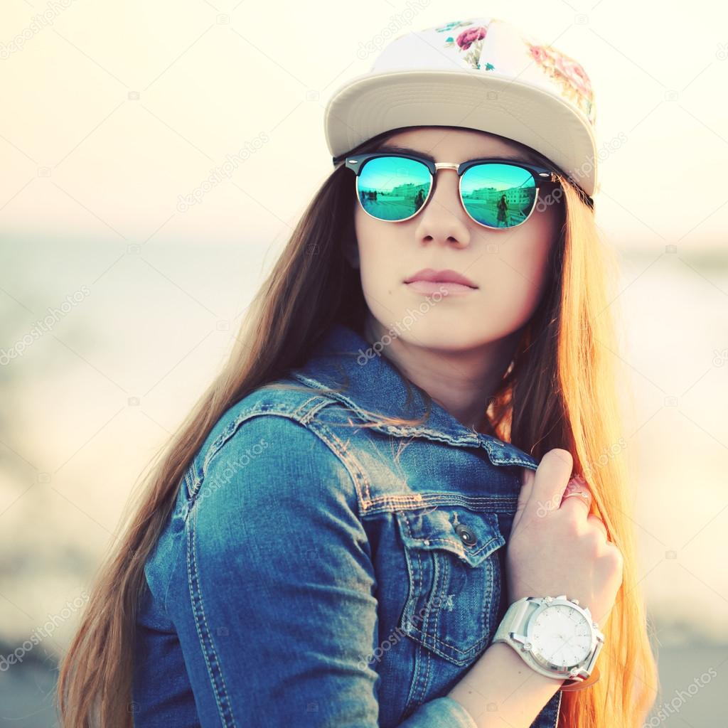 Outdoor Fashion Portrait Of Stylish Swag Girl Wearing Swag Cap Trendy Sunglasses And Denim