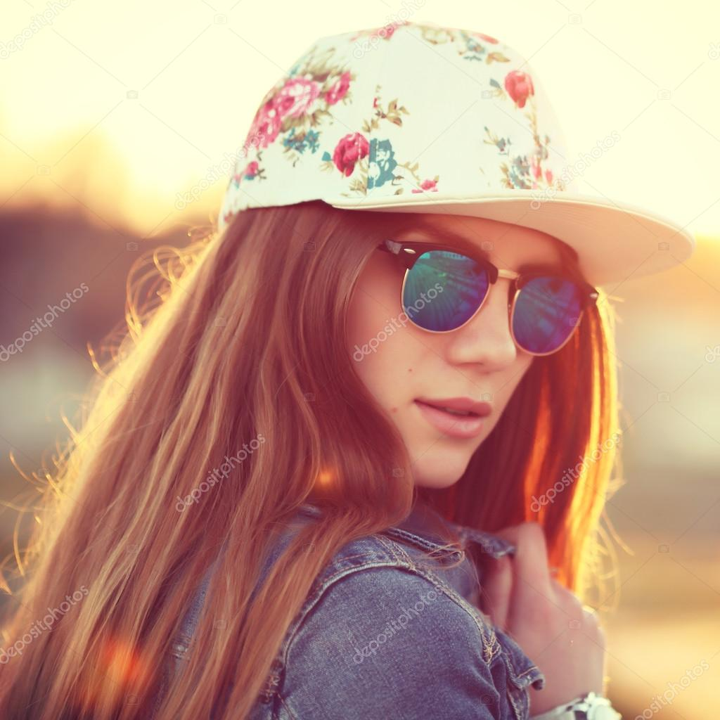 Outdoor fashion portrait of stylish swag girl, wearing swag