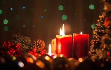 Burning candles in the Christmas night atmosphere
