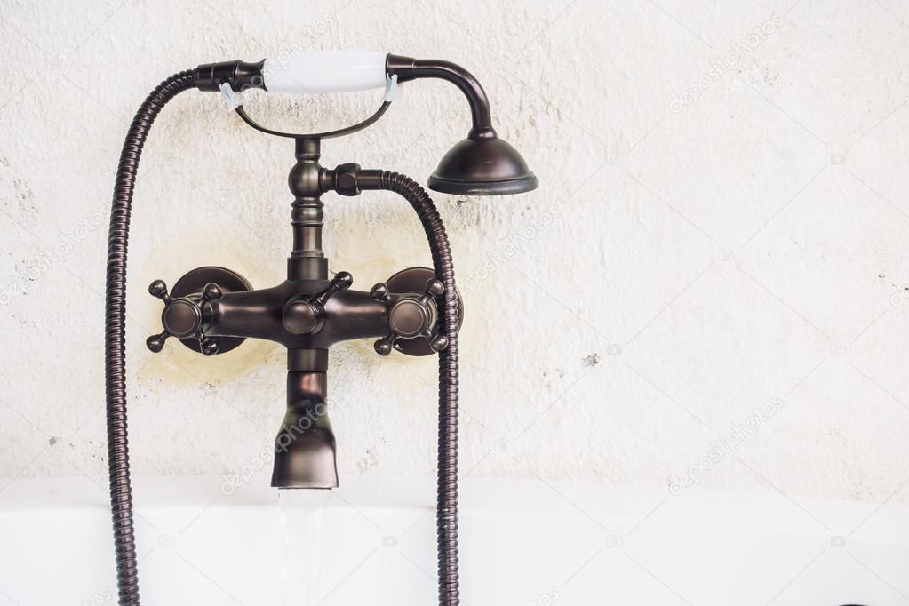 Old vintage faucet on bathtub — Stock Photo © mrsiraphol #100203898