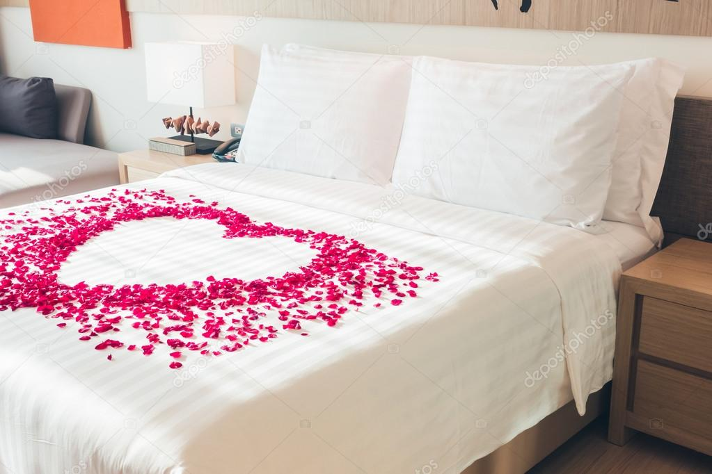Bed With Rose Petals White Pillows On Bed And Rose Petals Stock Photo C Mrsiraphol 103301042