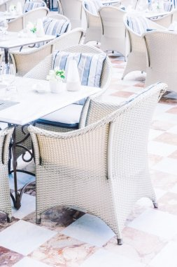tables and chairs setting for dinning in restaurant