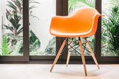 Orange chair with light lamp