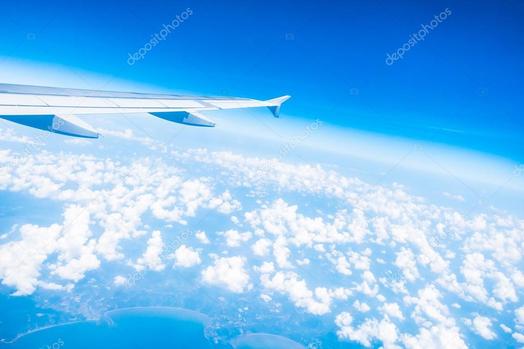 Airplane wing on beautiful blue sky