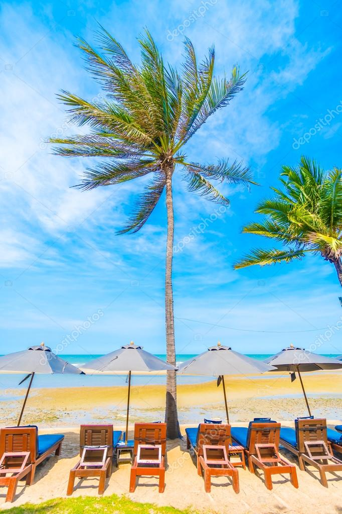 Umbrella and chair on tropical beach